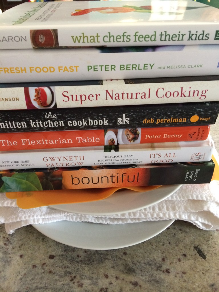 Some of my favorite books piled atop tofu to press it.