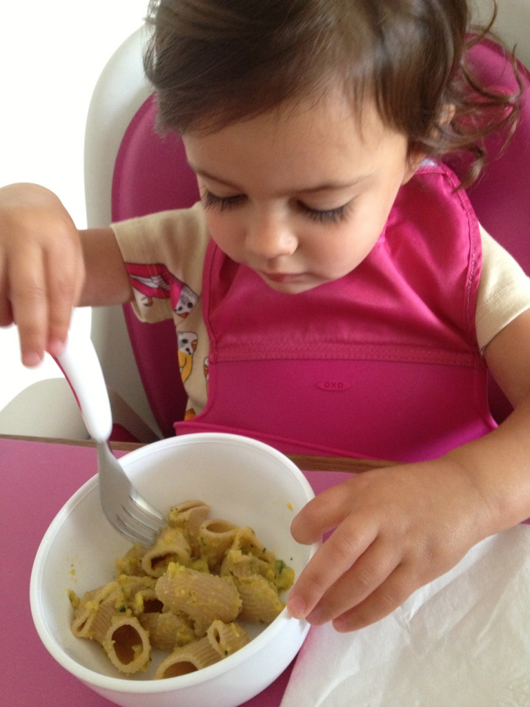 My toddler enjoying her Vegan pasta sauce