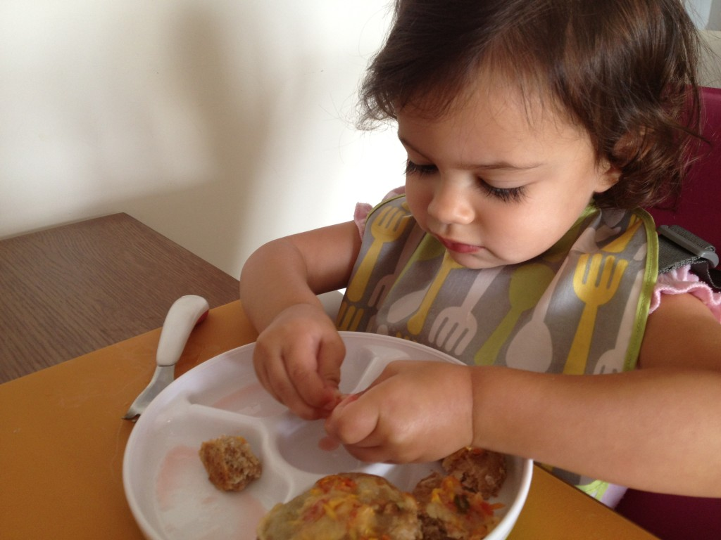 My toddler enjoying her primavera pizzette