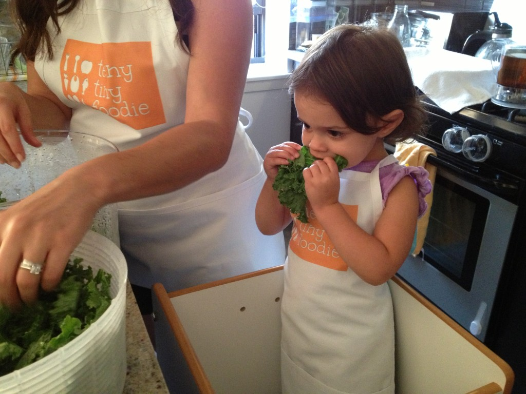 My toddler took a break from tearing and massaging raw kale so she could eat some.