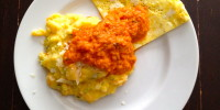 Polenta with fresh corn, carrots and zucchini with a fried egg