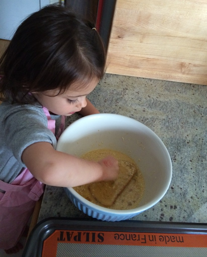 Dipping the bread for Coconut French Toast from teeny tiny foodie