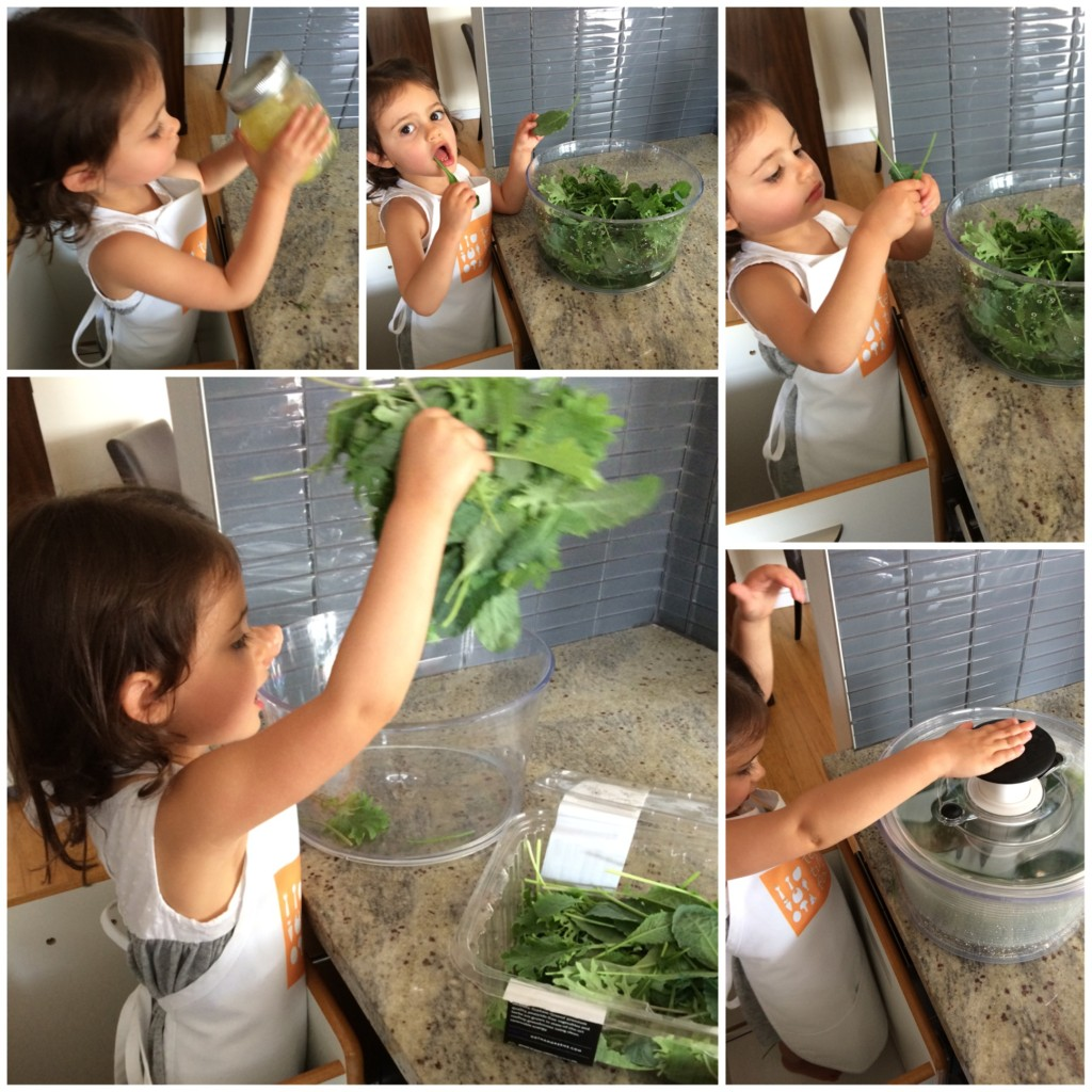 My toddler helping to prepare Shaved Apple & Baby Kale Salad from teeny tiny foodie