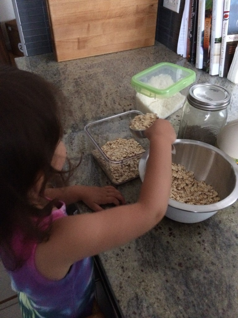 Measuring oats for Purple Overnight Oats from teeny tiny foodie