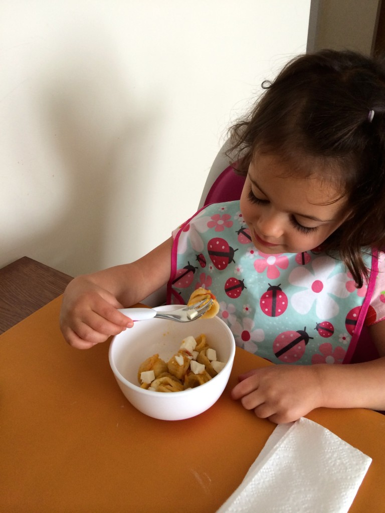 The obligatory pre-eating inspection by a toddler of Yellow Squash and Tarragon Purée Pasta from teeny tiny foodie