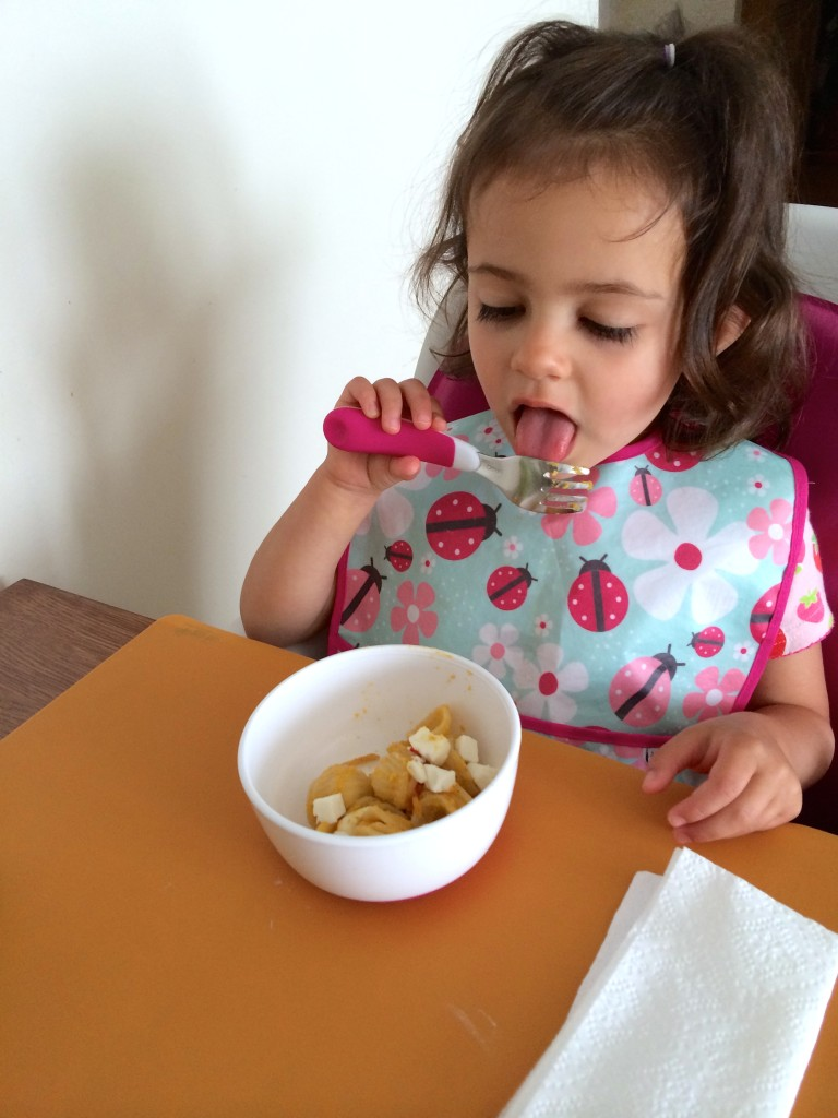 With the teeniest tiniest bit of sauce on her fork, she finally tastes it. Yellow Squash and Tarragon Purée Pasta from teeny tiny foodie