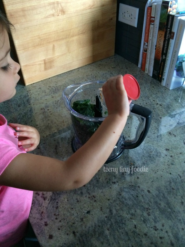 Adding coconut water to a Nutty Green Smoothie from teeny tiny foodie