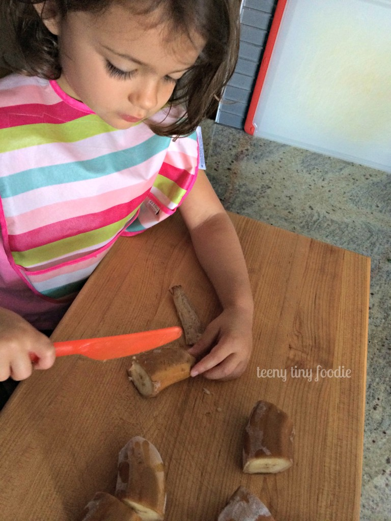 Trying to scrape the peel off a frozen banana to make a Nutty Green Smoothie from teeny tiny foodie