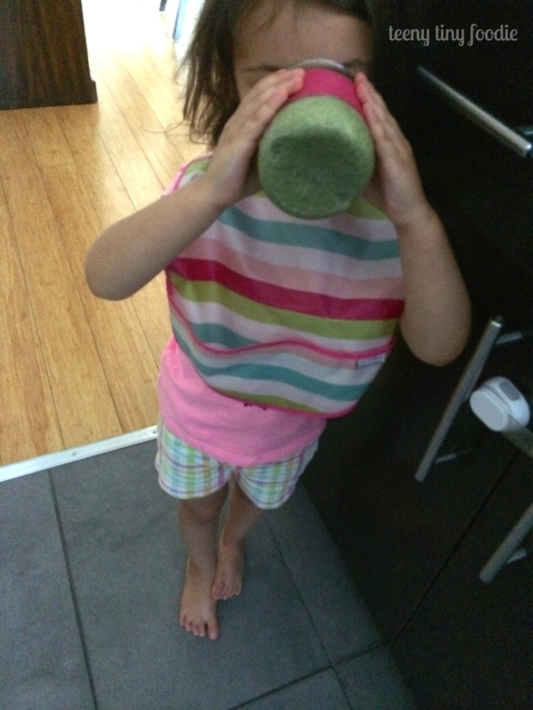 Enjoying her Nutty Green Smoothie from teeny tiny foodie