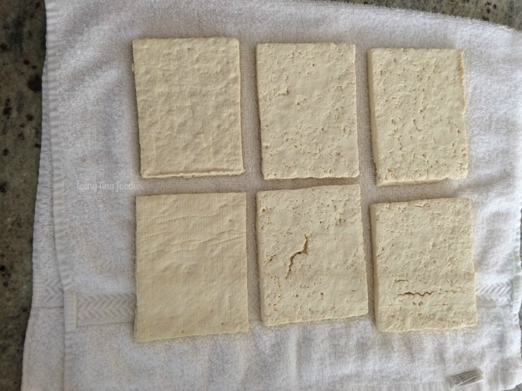 Tofu rectangles ready for pressing from Cracker Jack Quinoa from teeny tiny foodie