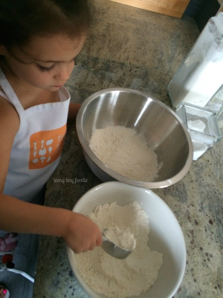 If you pour the flour into a large bowl it is easier for a toddler to scoop out and measure from teeny tiny foodie