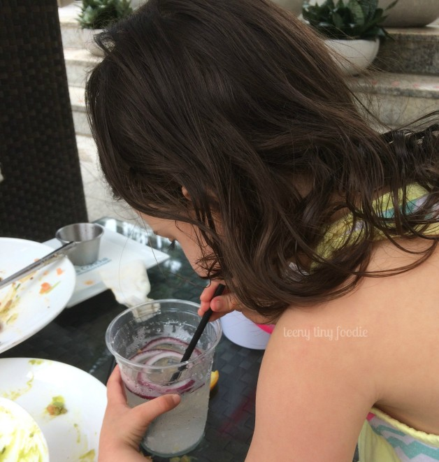 """Some people like to add fruit or herbs to flavor their water. Eliana? She added raw onions she picked off my plate at lunch time. She drank the whole cup! Will """"Onion Water"""" become all the rage at spas and resorts? Stranger things have happened!"""