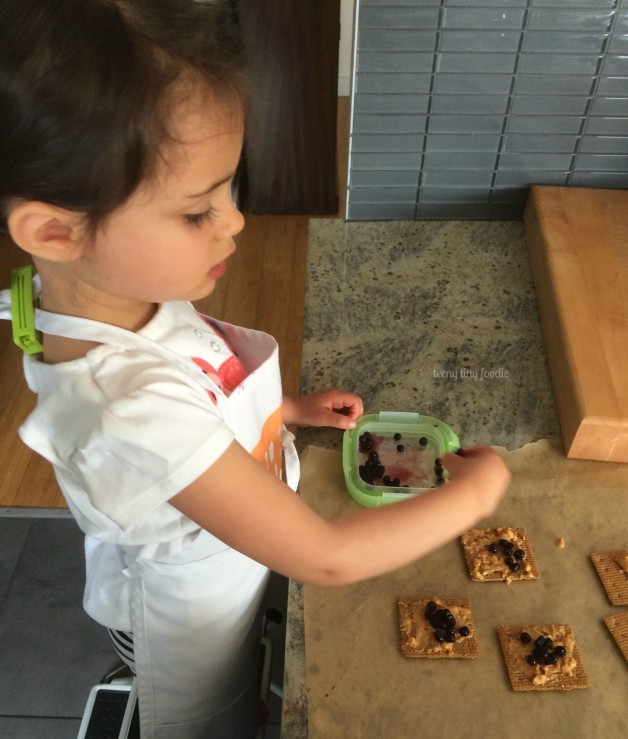 Eliana's PB&J Ice Cream Sandwiches from teeny tiny foodie are a sweet #dessert to cool you down during the #summer heat. They are an #easy #recipe that this toddler created all by herself. #teenytinyfoodie #KidsCookMonday #kidsinthekitche
