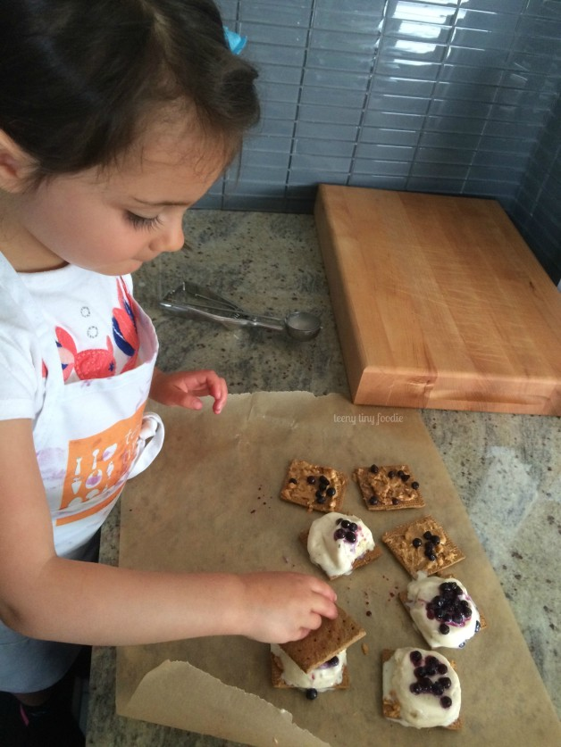 Eliana's PB&J Ice Cream Sandwiches from teeny tiny foodie are a sweet #dessert to cool you down during the #summer heat. They are an #easy #recipe that this toddler created all by herself. #teenytinyfoodie #KidsCookMonday #kidsinthekitchen