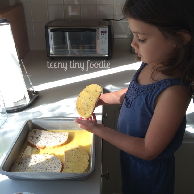 Look at my #teenytinysouschef go! I love that she was so excited to help make french toast for dinner. Cooking together helps to make this new kitchen feel like OUR kitchen. #teenytinyfoodie #creatingateenytinyfoodie
