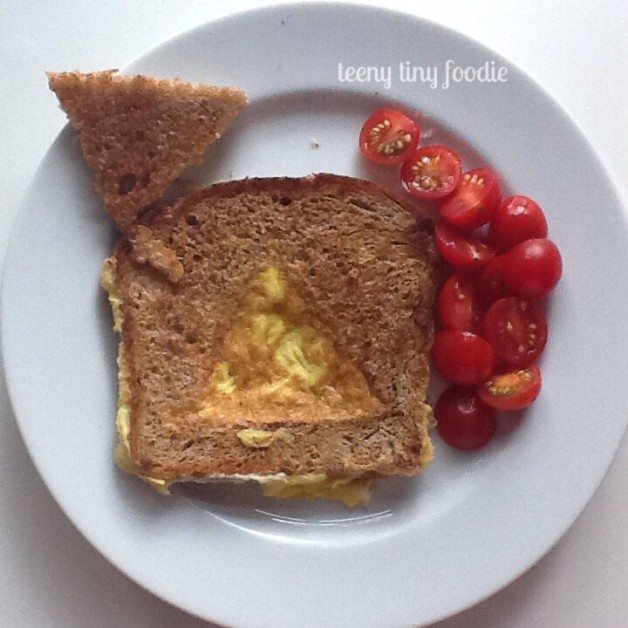 """Dinner with a side of geometry. Who says the shape you make for your for """"Eggs in a Hole"""" has to be a circle? I like to mix it up for Eliana (and #tbt myself) with different shapes. She gets a healthy dinner and a little math skills too. #teenytinyfoodie"""