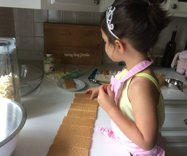Counting out ingredients is a great way to work on math skills in the kitchen! Here we're making Sweet & Salty Cereal Treats. #teenytinyfoodie #kidsinthekitchen #KidsCookMonday