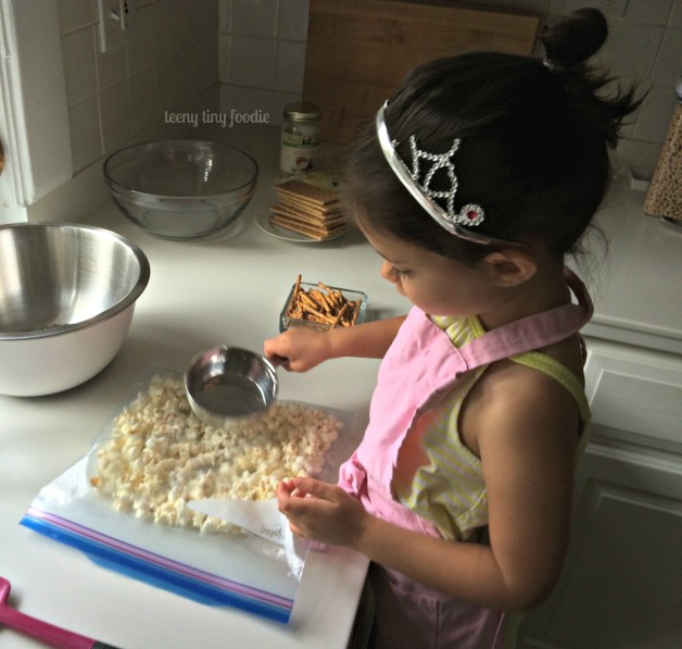 Smashing ingredients is something even a young sous chef can do. Plus, it's a great way to get out a little energy or release some tension if needed. Here we're making Sweet & Salty Cereal Treats. #teenytinyfoodie #kidsinthekitchen #KidsCookMonday
