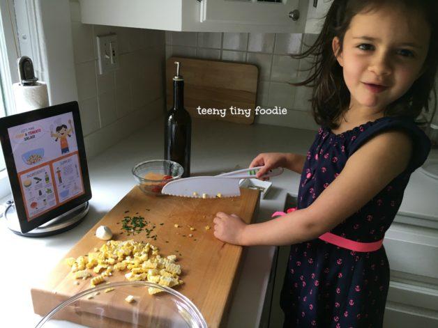 Eliana cooking Corn and Tomato Salad
